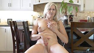 Naughty mature Velvet Skye drops her briefs and masturbates