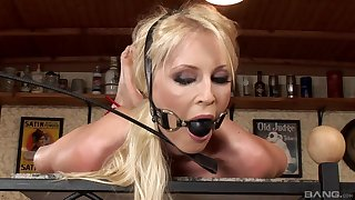 MILF is gagged coupled with roughly fucked for a complete BDSM sex counterfeit