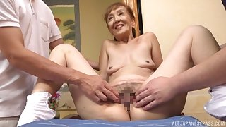 A remarkable threesome Japanese duplicate fool around with a sexy granny